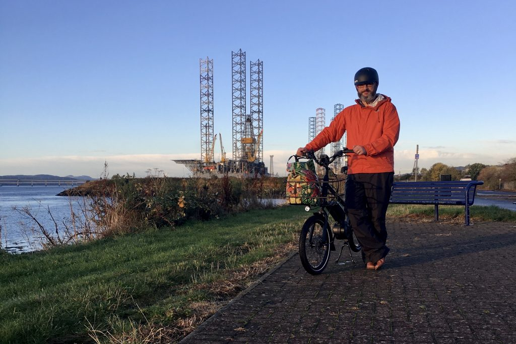 The writer standing beside his e-bike on the cycle path between Dundee and Broughty Ferry